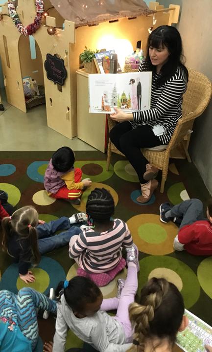 Teacher engaging children in a read aloud