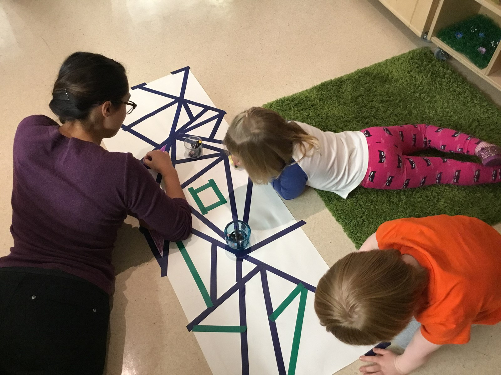 Image of children working on a collaborative art activity