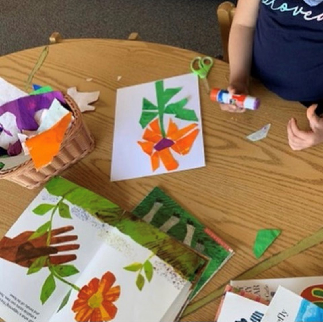 Image of students working on artwork from a story