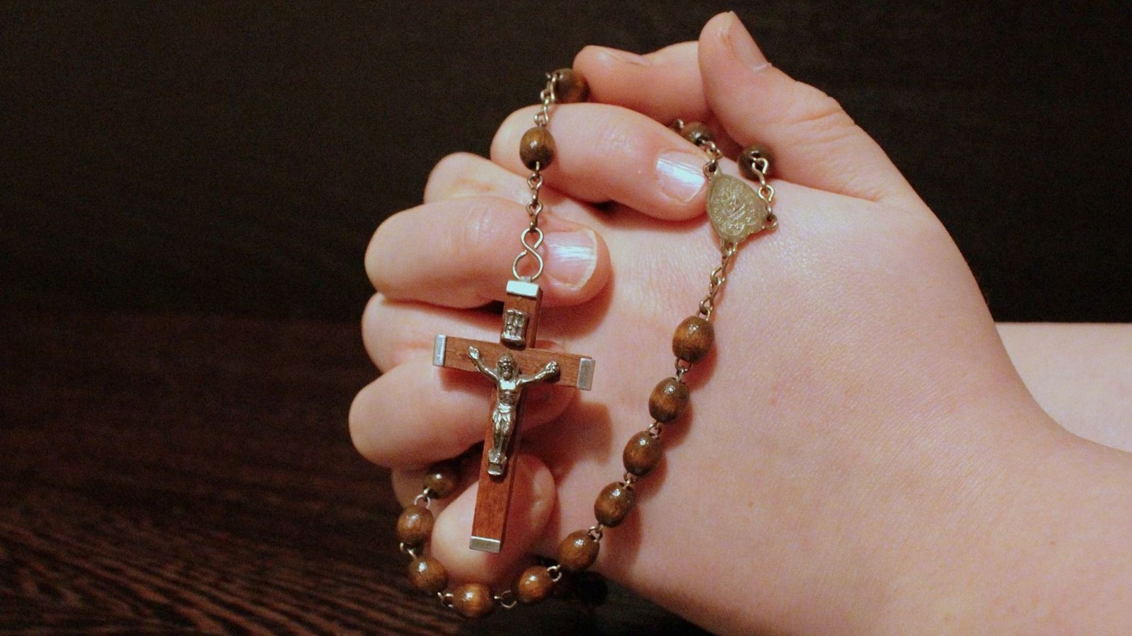Rosary in child's hand